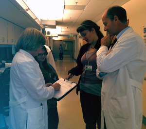 Figure 3: Dr. Mann's UWMC clinic team huddle consisting of Vic Shorten, RN, Braelynn Atkinson, MA, Sara Murphy, PSS and Gary Mann, MD. Not shown but often present in the huddle is Darlene Brown, PCC.