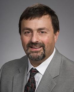 Headshot portrait of Dr. Alessandro Fichera, surgery.